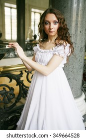 Portrait of a beautiful young victorian lady in white dress