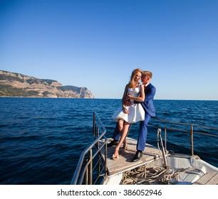 Portrait of beautiful young wedding couple on sea background