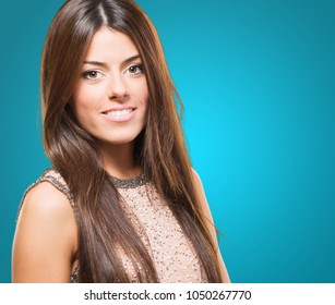 Portrait of a beautiful young woman against a blue background