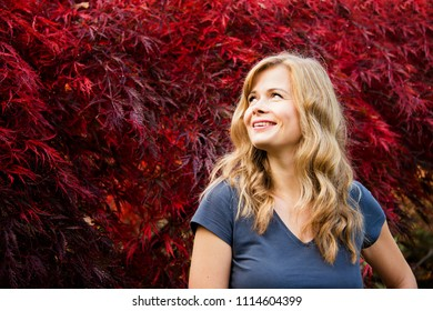 Portrait of beautiful young woman in autumn park
