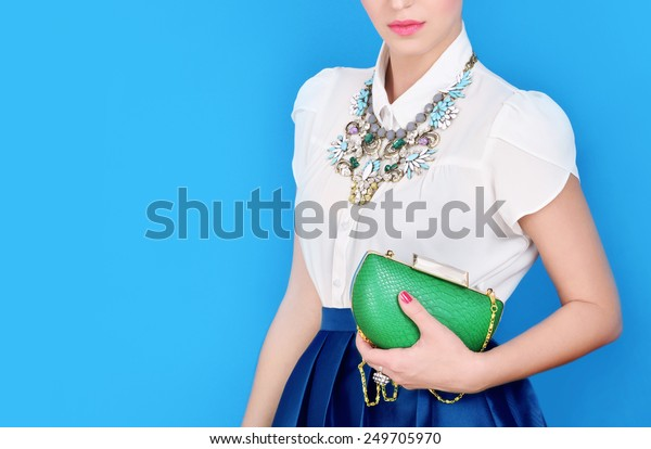 Portrait of beautiful young woman with bag.Fashion photo