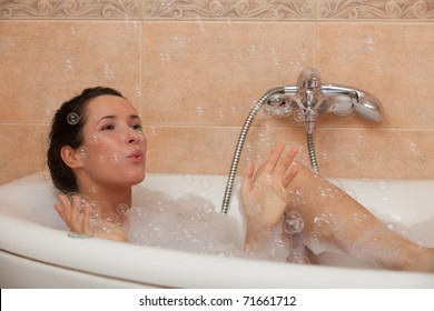 Portrait of a beautiful young woman in a bathroom. Concept body care.