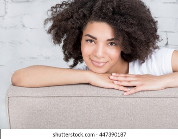 Portrait of a beautiful young woman with black hair at home