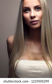 Portrait of a beautiful young woman with blonde hair