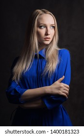 Portrait of beautiful young woman with blue eyes. Studio shot.
