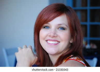 Portrait of a beautiful young woman with blue eyes