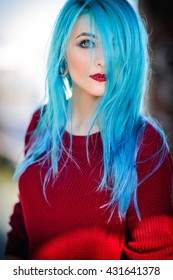 Portrait of a beautiful young woman with blue hair