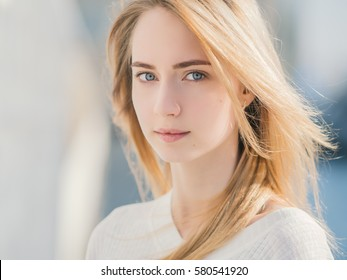 Portrait of a beautiful young woman with blue eyes. Soft focus.