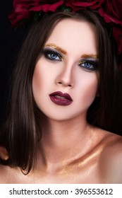portrait of a beautiful young woman with bright makeup
