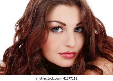 Portrait of beautiful young woman with brown curly hair