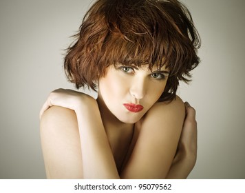 portrait of a beautiful young woman with brown short hairs