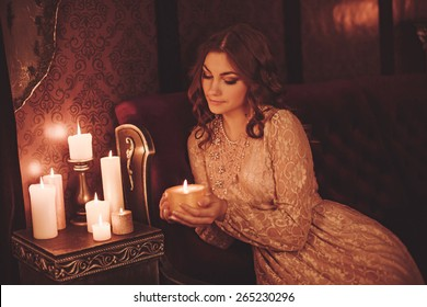 Portrait of beautiful young woman with candles