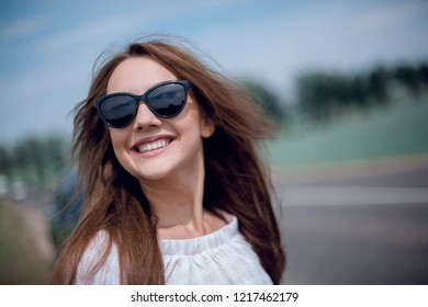 portrait of a beautiful young woman in the car