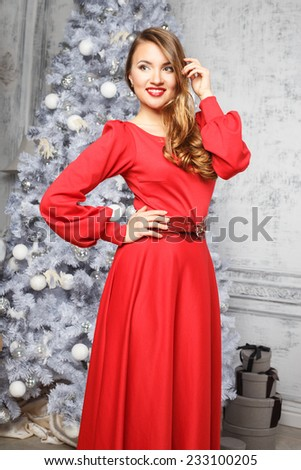 06cb6feff6a0 Portrait of a beautiful young woman in casual dress over christmas  background