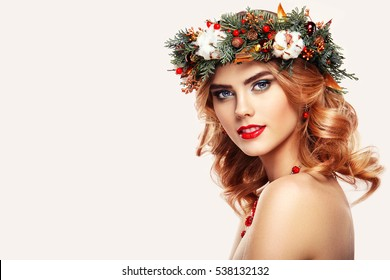 Portrait of beautiful young woman with Christmas wreath. Beautiful New Year  and Christmas tree holiday e4c8c03bf722