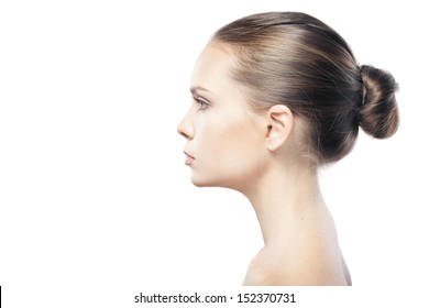 portrait of beautiful young woman with clean skin isolated on white background  with copyspace
