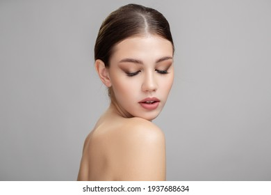 portrait of beautiful young woman with clean face closed eyes
