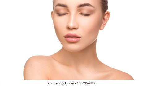 Portrait of beautiful young woman with closed eyes. Pure, natural skin. Isolated on white. Skin care and woman health concept.
