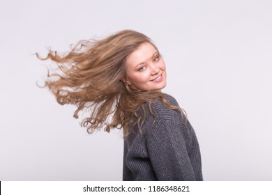 Portrait of beautiful young woman with curly wave hair