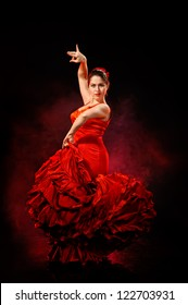 Portrait of  beautiful young woman dancing flamenco in red dress