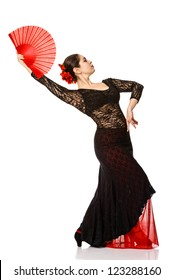 Portrait of  beautiful young woman dancing flamenco . Isolated on white