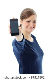 Portrait of beautiful young woman displaying mobile phone on white background