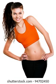 Portrait of beautiful young woman dressed in orange sportswear posing isolated on white background