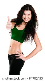 Portrait of beautiful young woman dressed in green sportswear posing isolated on white background
