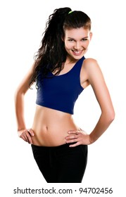 Portrait of beautiful young woman dressed in blue sportswear posing isolated on white background