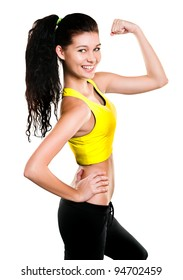 Portrait of beautiful young woman dressed in yellow sportswear posing isolated on white background