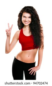 Portrait of beautiful young woman dressed in red sportswear posing isolated on white background