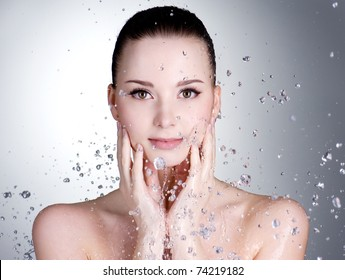 Portrait of beautiful young woman with drops of water around her face - horizontal