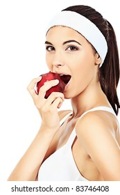 Portrait of a beautiful young woman eating apple. Isolated over white background.