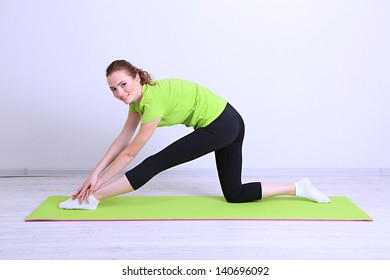 Portrait of beautiful young woman exercises
