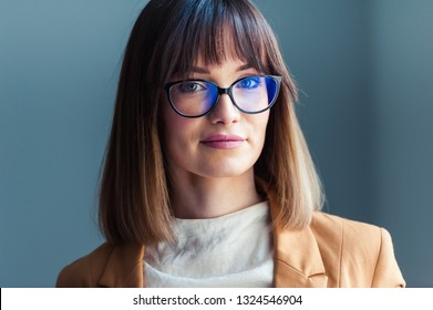Portrait of beautiful young woman in eyeglasses