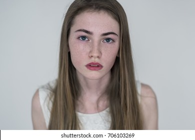 Portrait of a beautiful young woman with freckles close-up