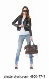 portrait of beautiful young woman Girl in sunglasses and jeans. Girl with handbag