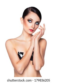 Portrait of a beautiful young woman with a glamorous retro makeup