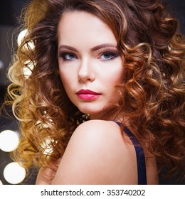 Portrait of beautiful young woman in glamour fashion dress and perfect make up and hair style