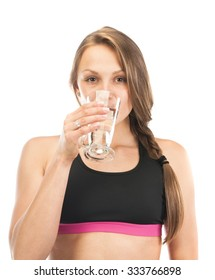 Portrait of beautiful young woman with a glass of water smiling and looking to camera,  isolated on white background