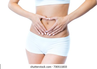 Portrait of beautiful young woman with hands on belly-stomach ache over white background.
