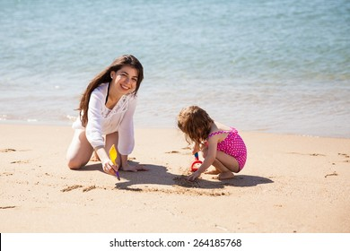 Portrait of a beautiful young woman having a great time at the beach with her daughter