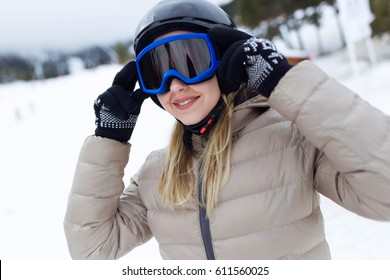 Portrait of beautiful young woman having fun over winter background.