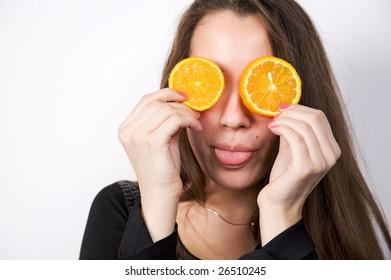 Portrait of beautiful young woman holding fresh orange fruit