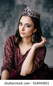portrait of a beautiful young woman in an image of the Queen, colored dress Marsala - Shutterstock ID 554945851