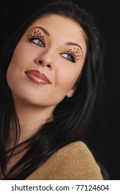 portrait of beautiful young woman with beautiful leopards make-up