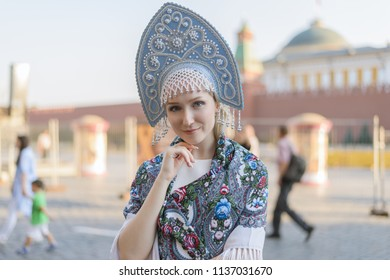 Portrait of beautiful young woman in light blue kokoshnik.