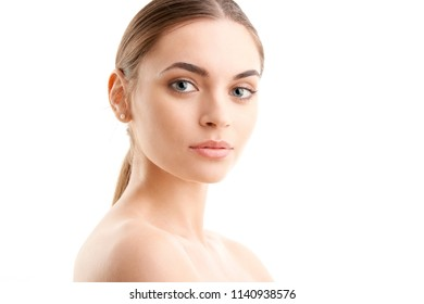 Portrait of a beautiful young woman looking at camera and posing at isolated white background.