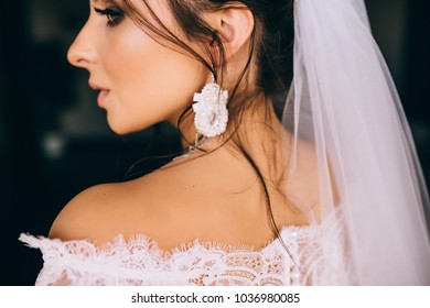Portrait of a beautiful young woman. Makeup and hairstyle in bride. Close up. Wedding morning. Gentle, Tender emotion on the face.