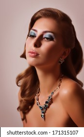 Portrait of beautiful young woman with makeup with jewelry precious decorations